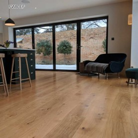 Fitting wide oak boards engineered London By Fin Wood