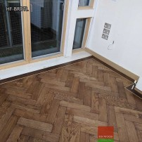 Herringbone flooring with border and tramline by Fin Wood Ltd London