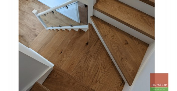 Engineered oak stair cladding with modern white painted risers uplifts a semi-detached family home, Epping Forest