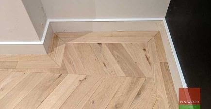 Distinctive wide angled oak chevron parquet replica in West Hampstead playroom, NW6 #CraftedForLife