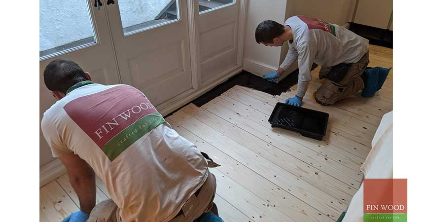Dramatically dark ebony wood oil used for a pine floor restoration project in a Victorian conversion flat in Clapham, SW11 #CraftedForLife