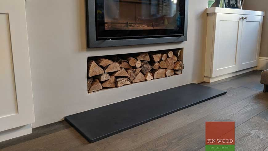 Flooring arround fireplace in London by Fin Wood