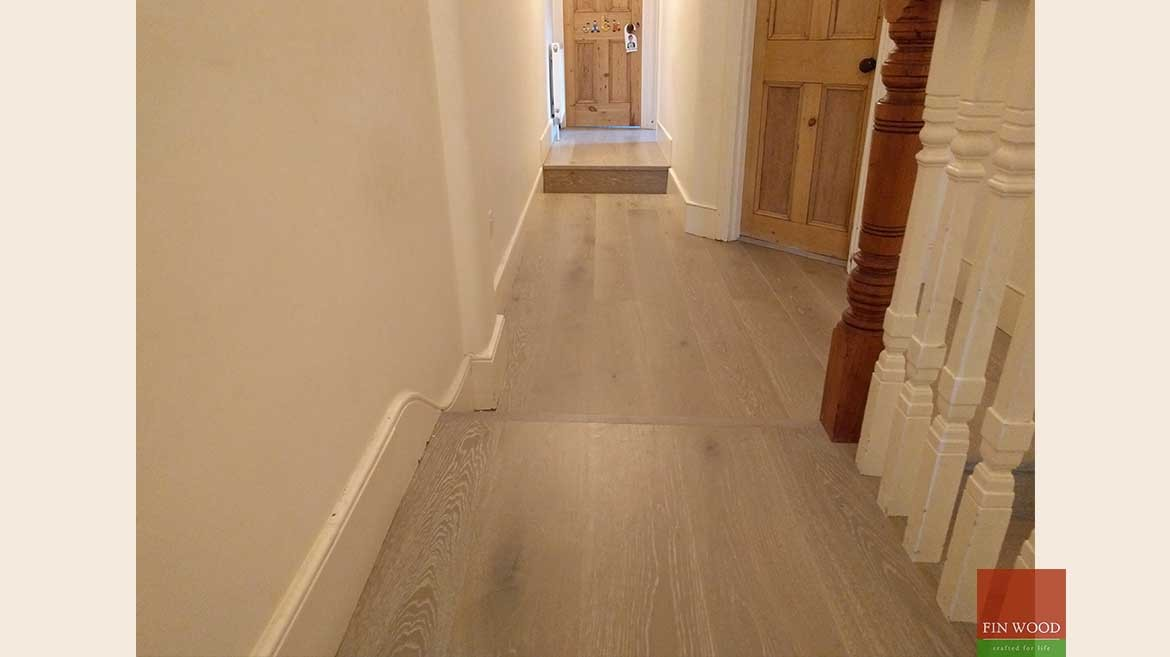 Wood floor transition between floor heights - by Fin Wood Ltd