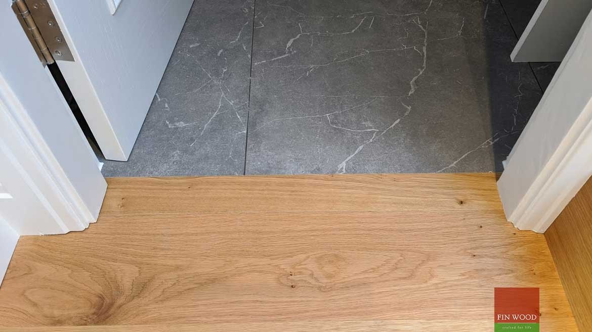 Transition to tiles and carpet in wood flooring by Fin Wood Ltd #CraftedForLife