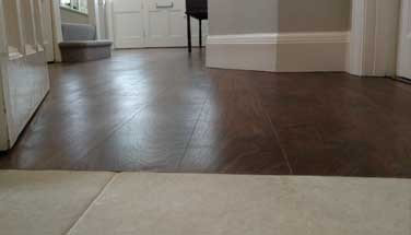WOOD FLOOR TO TILES AND CARPET
